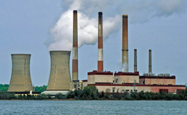View of the Chalk Point Generating Station from the Patuxent River, showing the plant's two cooling towers and three smokestacks.