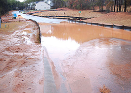 Photo: Mud fills the street along a construction site.