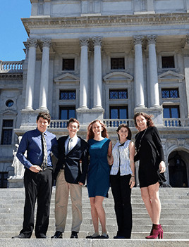 Five members of CBF's Student Leadership Council stand on the steps of the PA Capitol building.