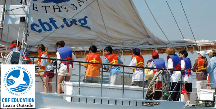 Students on Skipjack - with Learn Outside logo 695x352